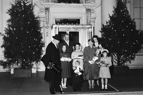 President Eisenhower poses for Christmas pictures at the White House with his family on December 23rd, 1958.