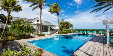 Swimming pool, Property, Arecales, Tree, Real estate, Resort, Woody plant, Azure, Tropics, Composite material,