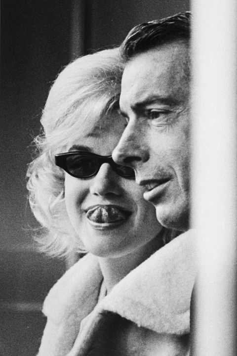 Candid of actress Marilyn Monroe (L) & ex-husband Joe DiMaggio (R) attending opening game at Yankee Stadium.  (Photo by Lee Lockwood/The LIFE Images Collection/Getty Images)