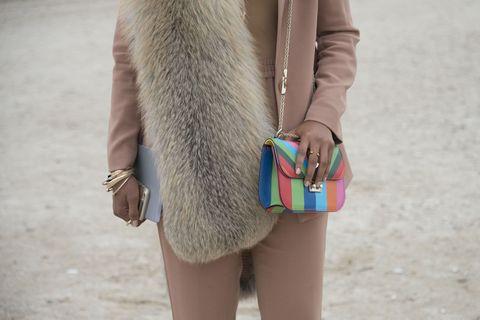 Human, Textile, Hand, Outerwear, Khaki, Bag, Coat, Fashion accessory, Street fashion, Jacket,