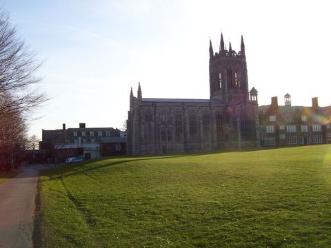 Grass, Window, Building, Land lot, Spire, Lawn, Steeple, Medieval architecture, Manor house, Gothic architecture,