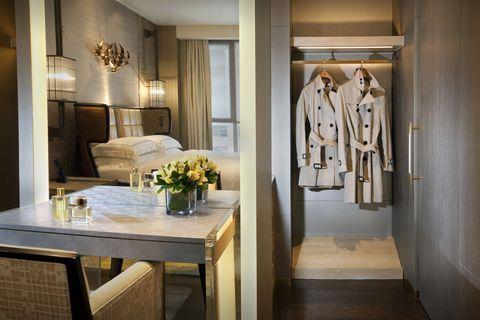 Interior design, Table, Room, Floor, Flooring, Interior design, Ceiling, Light fixture, Centrepiece, Couch,