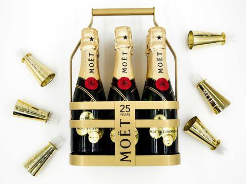 Bottle, Glass bottle, Font, Drink, Alcoholic beverage, Bottle cap, Metal, Gold, Brass, Distilled beverage,