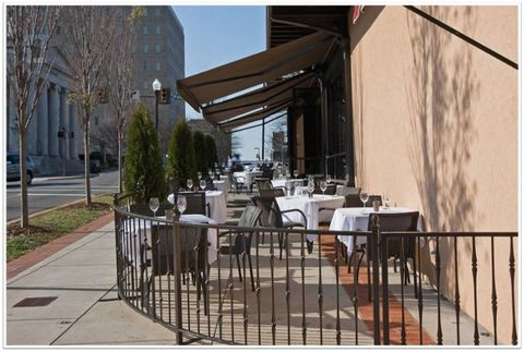 Neighbourhood, Table, Iron, Outdoor table, Restaurant, Real estate, Chair, Tablecloth, Outdoor furniture, Metal,