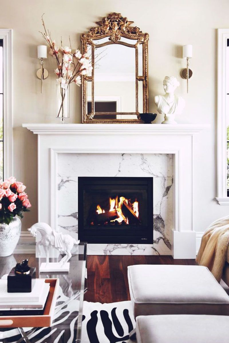 """<p>A touch of gold from a mantel mirror or table top pieces renders a warm vibe that's ideal for winter.</p><p><em><a href=""""http://www.mydomaine.com/"""" target=""""_blank"""">Via My Domaine</a></em> </p>"""