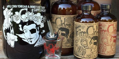 Brown, Bottle, Glass bottle, Alcohol, Alcoholic beverage, Liquid, Drink, Logo, Drinkware, Barware,