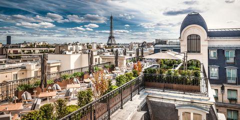 Cloud, Neighbourhood, Roof, Urban area, Metropolitan area, Residential area, Tower, Cityscape, Urban design, Dome,