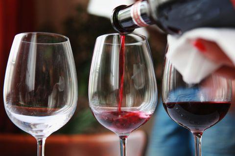 Stemware, Glass, Drinkware, Fluid, Wine glass, Drink, Barware, Red, Alcoholic beverage, Bottle,