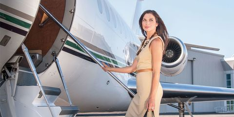 Woman entering private jet