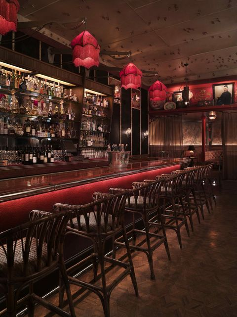 Lighting, Light fixture, Barware, Ceiling, Restaurant, Ceiling fixture, Drinking establishment, Lighting accessory, Bottle, Tavern,