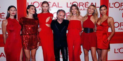 Dress, Trousers, Red, Formal wear, Coat, Style, Flooring, Cocktail dress, Premiere, Carpet,