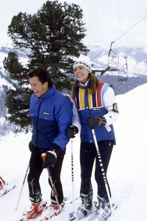 Skier, Snow, Footwear, Snowshoe, Skiing, Ski, Outdoor recreation, Nordic skiing, Ski mountaineering, Recreation,