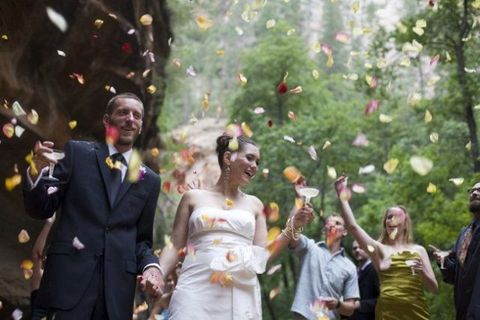Dress, Coat, Outerwear, Happy, Suit, Formal wear, People in nature, Confetti, Ceremony, Bridal clothing,