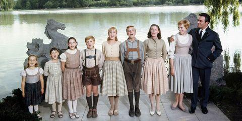 Footwear, Leg, People, Social group, Waist, Dinosaur, Beige, Vintage clothing, Day dress, One-piece garment,