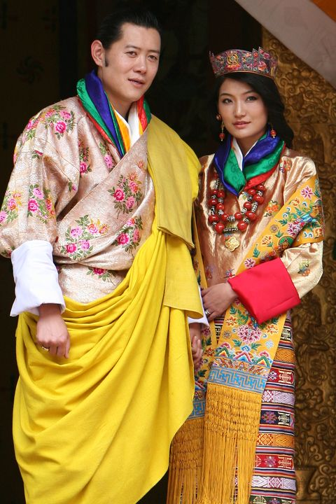 Yellow, Human body, Textile, Tradition, Magenta, Headgear, Fashion accessory, Temple, Maroon, Silk,