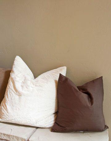 karate chopped pillows on a ledge