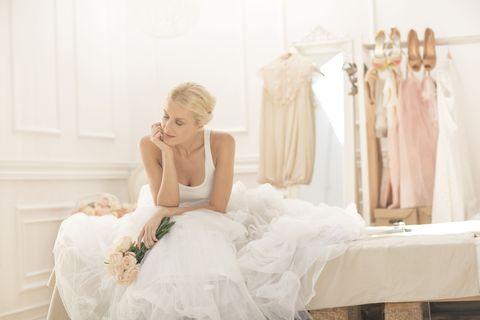 Clothing, Shoulder, Dress, Bridal clothing, Textile, Gown, Clothes hanger, Wedding dress, Fashion, Bride,