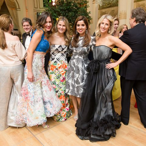 Clothing, Smile, Event, Dress, Trousers, Coat, Textile, Outerwear, Formal wear, Strapless dress,