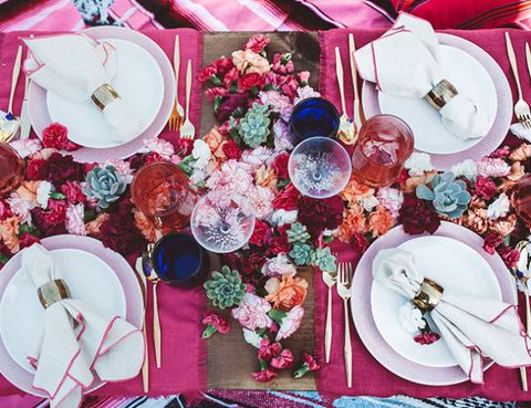 "<p>Designed by <a href=""http://sittinginatreedesign.com/"" target=""_blank"">Sitting In A Tree</a>, this tablescape used vibrant shades of berry and tangerine and layered serape blankets for a sophisticated spin on a Mexican-inspired fiesta.</p><p>Via <a href=""http://www.inspiredbythis.com/dwell/end-of-summer-bohemian-backyard-party/"" target=""_blank"">Inspired By This</a></p>"