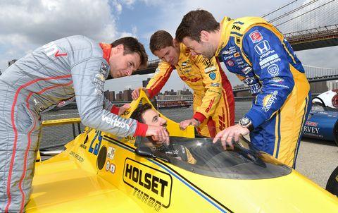 Motor vehicle, Automotive design, Yellow, Logo, Team, Windshield, Race car, Touring car racing, Hood, Crew,