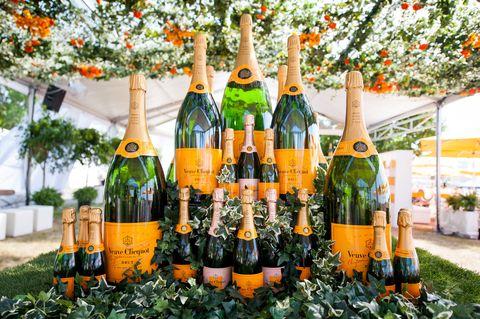 Glass bottle, Yellow, Bottle, Drink, Alcohol, Alcoholic beverage, Orange, Distilled beverage, Drinkware, Bottle cap,