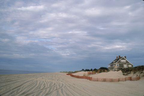 Cloud, Sand, Landscape, Aeolian landform, Singing sand, Meteorological phenomenon, Beach, Building material, Cottage, Dune,