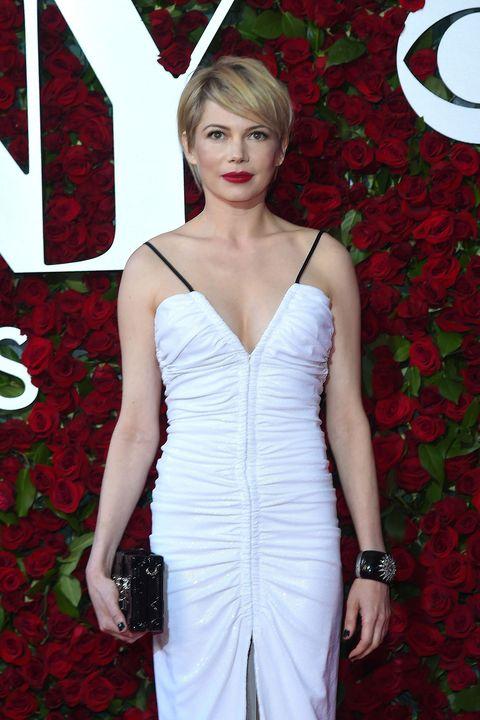 Red, Dress, Petal, Carmine, Fashion model, Day dress, Watch, Waist, Model, One-piece garment,