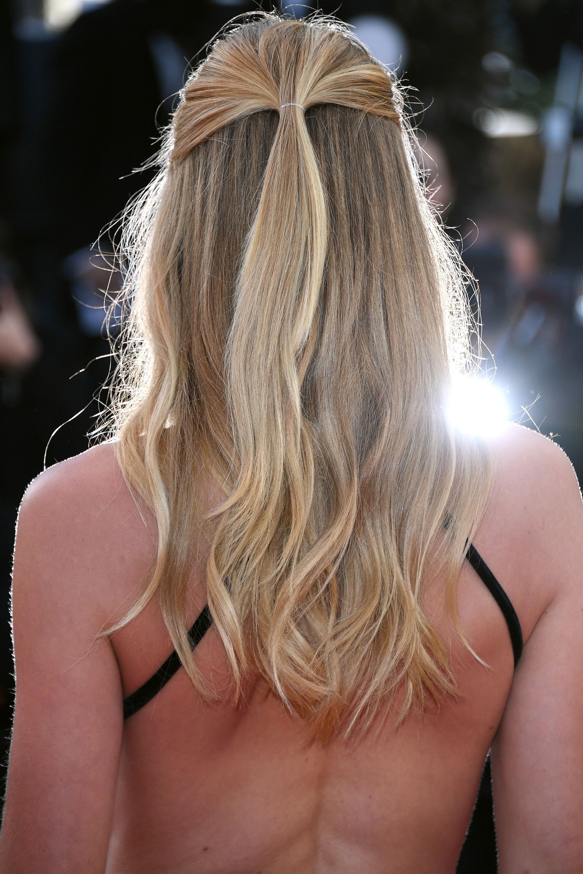 """CANNES, FRANCE - MAY 11:  Model Doutzen Kroes (hair detail) attends the """"Cafe Society"""" premiere and the Opening Night Gala during the 69th annual Cannes Film Festival at the Palais des Festivals on May 11, 2016 in Cannes, France.  (Photo by Venturelli/WireImage)"""