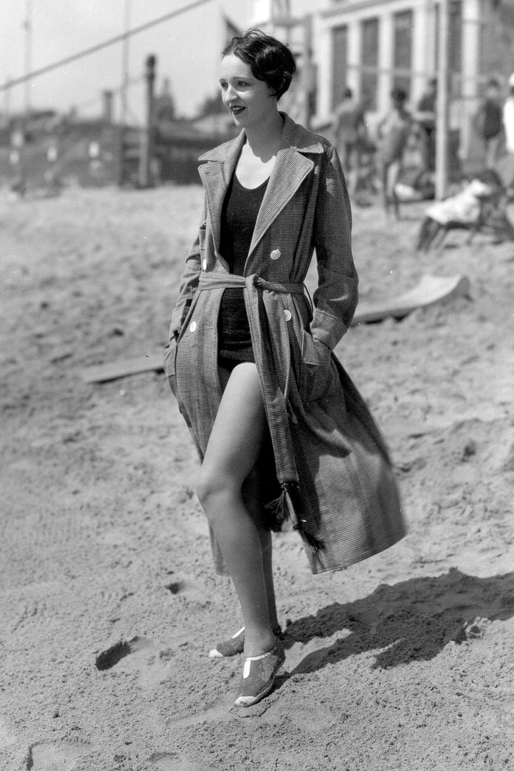 <p>The duster jacket may have been an A-List favorite amongst Kendall Jenner, Chrissy Teigen, Kim K and more this spring but take note from the ladies of the '20s and wear it as a coverup on the beach this summer. </p>