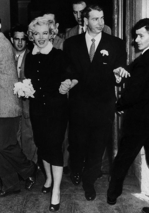 The American actress Marilyn Monroe and her husband Joe DiMaggio leaving the town hall after their wedding. San Francisco, 14th January 1954 (Photo by Mondadori Portfolio via Getty Images)