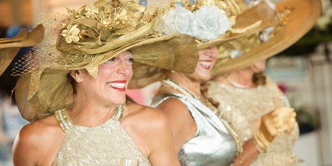 Clothing, Hat, Dress, Fashion accessory, Facial expression, Headgear, Costume accessory, Fashion, Sun hat, Tradition,