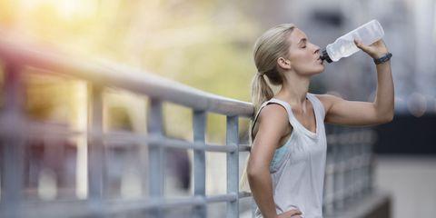 Elbow, Beauty, Sleeveless shirt, Drinking, Street fashion, Waist, Active tank, Portrait photography, Fence, Plastic bottle,