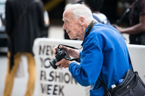 Camera, Bag, Street fashion, Single-lens reflex camera, Video camera, Leather, Photographer, Digital camera, Journalist, Wrinkle,