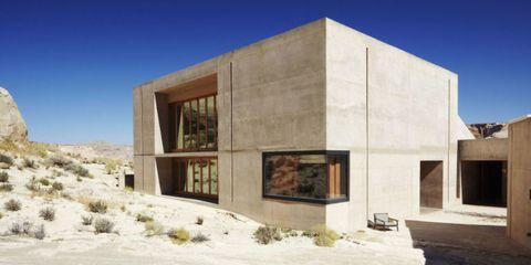 Wall, Facade, Land lot, Rock, Concrete, Composite material, Sand, Building material, Shrubland, Limestone,