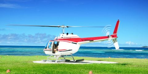Helicopter, Rotorcraft, Mode of transport, Aircraft, Natural environment, Glass, Air travel, Aviation, Helicopter rotor, Plain,