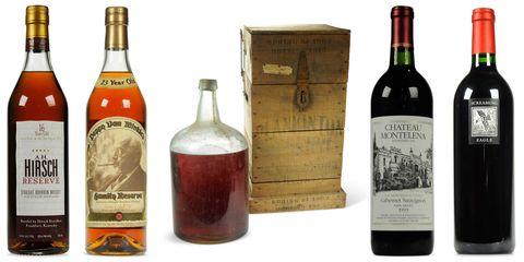 Glass bottle, Product, Bottle, Drink, Alcohol, Alcoholic beverage, Liquid, Red, Logo, Label,