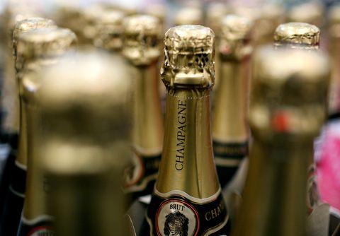 Bottle, Logo, Alcohol, Alcoholic beverage, Metal, Glass bottle, Brass, Still life photography, Label, Distilled beverage,