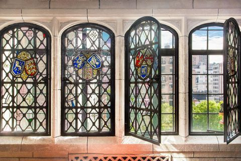 Glass, Stained glass, Fixture, Art, Arch, Iron, Building material, Daylighting, Window film, Holy places,