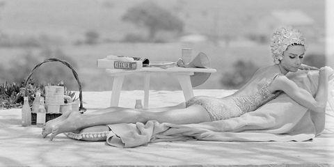Audrey Hepburn tanning