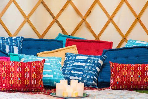 Blue, Textile, Room, Orange, Linens, Cushion, Pillow, Throw pillow, Majorelle blue, Candle,