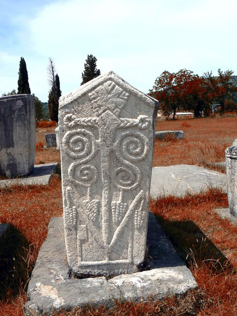 Headstone, Rock, Cemetery, Stele, Memorial, Artifact, Grave, Carving, Nonbuilding structure, Creative arts,