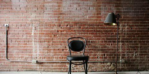 Brick, Wall, Brickwork, Building material, Light fixture, Iron, Still life photography, Armrest,