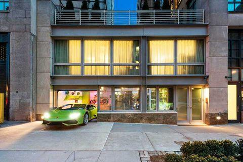 Facade, Automotive parking light, Classic car, Automotive lighting, Commercial building, Mixed-use, Luxury vehicle, City car, Door, Performance car,