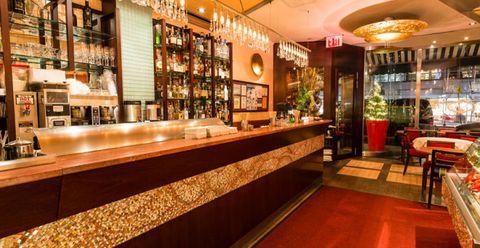 Lighting, Flowerpot, Barware, Amber, Drinking establishment, Interior design, Bottle, Houseplant, Restaurant, Tavern,