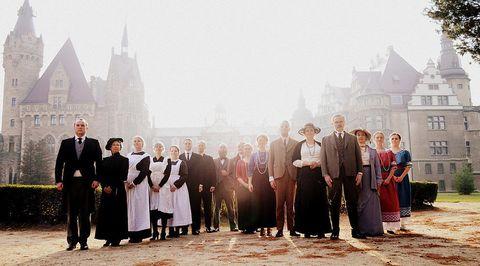 Social group, Atmospheric phenomenon, Spire, Steeple, Mist, Medieval architecture, Place of worship, Haze, Fog, Vintage clothing,