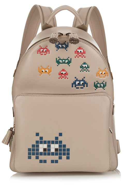 "<p><strong>Anya Hindmarch</strong> backpack, $1,450, <a href=""http://us.anyahindmarch.com/en-US/space-invaders-mini-backpack-5050925922425.html#start=5&cgid=backpacks"" target=""_blank"">anyahindmarch.com</a>. </p>"