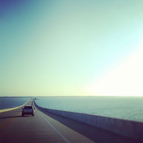 Blue, Road, Infrastructure, Road surface, Horizon, Ocean, Asphalt, Aqua, Teal, Guard rail,