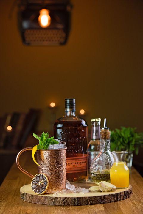 Lighting, Liquid, Bottle, Drink, Glass bottle, Drinkware, Juice, Tableware, Alcoholic beverage, Distilled beverage,