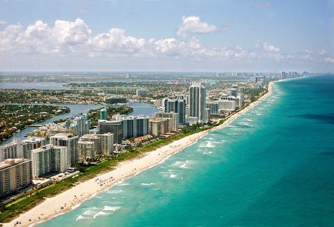 Body of water, Coastal and oceanic landforms, Coast, Shore, Property, Condominium, Water resources, Water, Metropolitan area, Tower block,