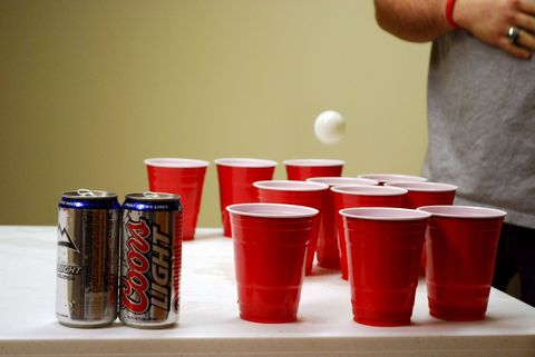 Beer pong, Red, Party supply, Drinking game, Cup, Tin can, Drink, Aluminum can, Plastic, Old fashioned glass,